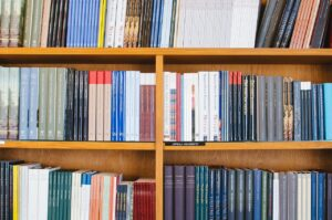 Photograph of a bookshelf with lots of organized books