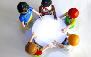 Toy figures sitting around a circular table